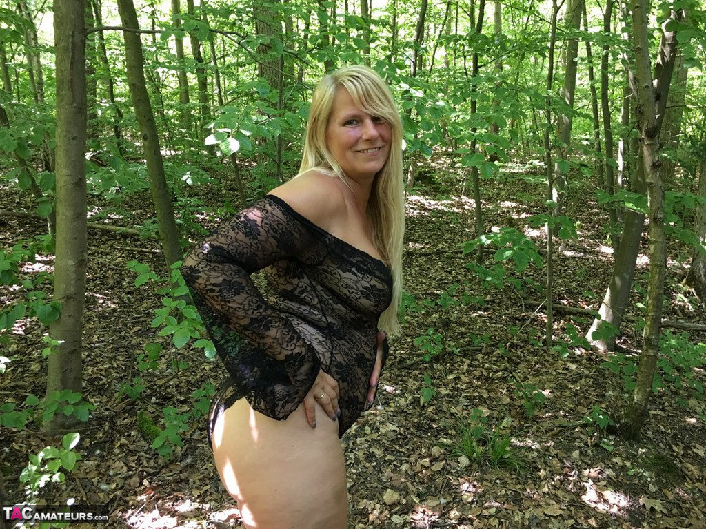 Naked chubby girl in forest