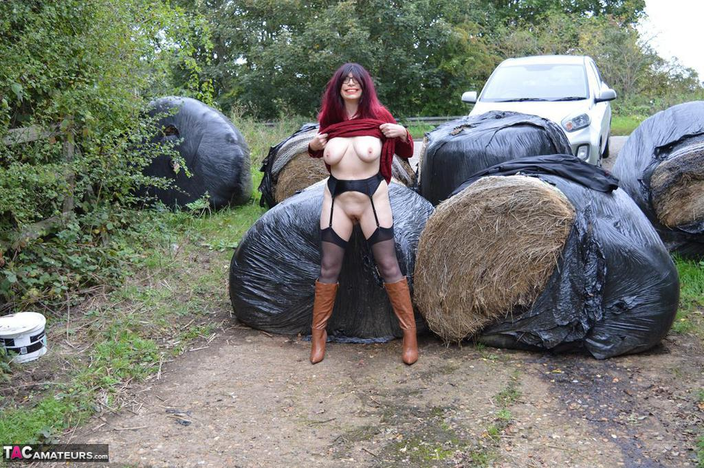 Mature housewife flashing her shaved cunt in the country